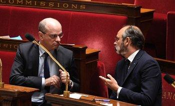 A la izquierda, el ministro de Educación, Jean-Michel Blanquer