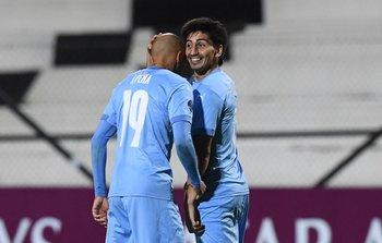 Agustín Peña con el hombre gol: Franco Pizzichillo