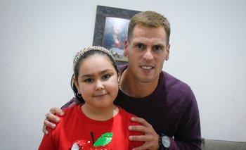Matías Fereira con su hija Ludmila de siete años