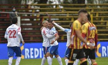 Ocampo y Bergessio celebran el 1-0