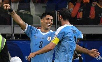 Luis Suárez y Diego Godín