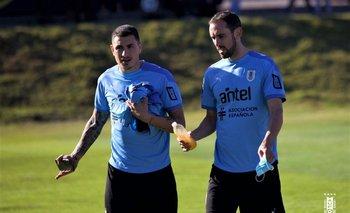 Josema Giménez y Diego Godín al final de la práctica