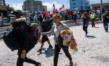 Decenas de venezolanos tuvieron que escapar de la marcha antimigrante realizada el sábado pasado en la ciudad de Iquique.