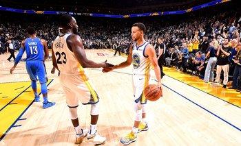 Draymond Green y Stephen Curry, de los Golden State Warriors, en el arranque de la temporada 2018/19 de la NBA