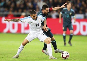 Torreira y Messi