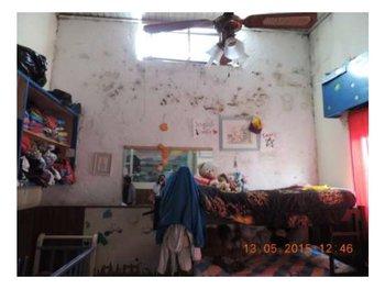 Dormitorio del Hogar Infantil de Minas