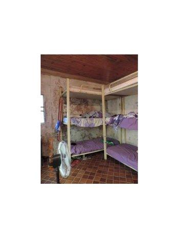 Dormitorio del Hogar Chacra Piri de Canelones
