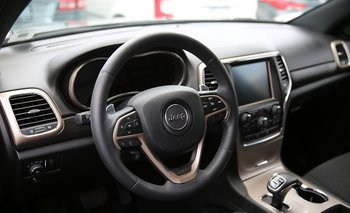 MIAMI, FL - JULY 24: The interior of a Fiat Chrysler Jeep Grand Cherokee is seen on a sales lot as the company announced it is recalling about 1.4 million Dodges, Jeeps, Rams and Chryslers vehicles equipped with certain radios on July 24, 2015 in Miami, Florida. The recall was announced after hackers were able to manipulate remotely a Jeep Cherokee