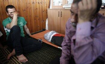Los parientes lloran la muerte del niño palestino