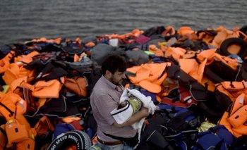 <p>Un refugiado sirio con su bebé luego de llegar a la isla de Lesbos, Grecia</p>  <p><br></p><p></p>
