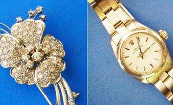 Un prendedor flor de oro con brillantes y reloj Rolex de Oro para dama de 18 quilates