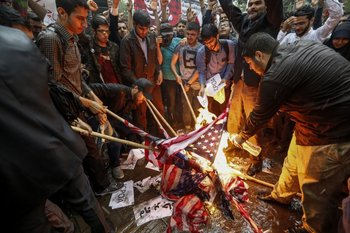<div>Iranians pour fuel on US flags set aflame during an anti-US demonstration outside the former US embassy headquarters in the capital Tehran on May 9, 2018. Iranians reacted with a mix of sadness, resignation and defiance on May 9 to US President Donald Trump