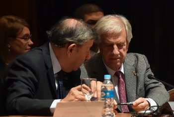 Uruguayan President Tabare Vazquez (R) and his Foreign Minister Rodolfo Nin Novoa attend the Mercosur Summit in Luque, Paraguay, on June 18, 2018. During the South American trading bloc