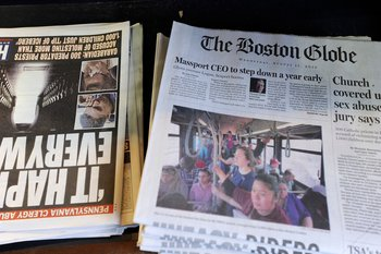Copies of the Boston Globe sit on the shelf with other daily papers at a newspaper stand at Boston