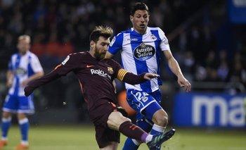 Lionel Messi y Fabian Schar