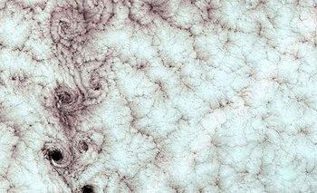 Remolinos de nubes Von Karman sobre la Isla Alexander Selkirk, en Chile.  Estas nubes parecen tener agujeros que las atraviesan y son, de hecho, atravesadas por remolinos de viento. En esta foto los remolinos de nubes fueron causados por un pico en la isla. La imagen fue tomada por un sensor del satélite Landsat 7 de la NASA.